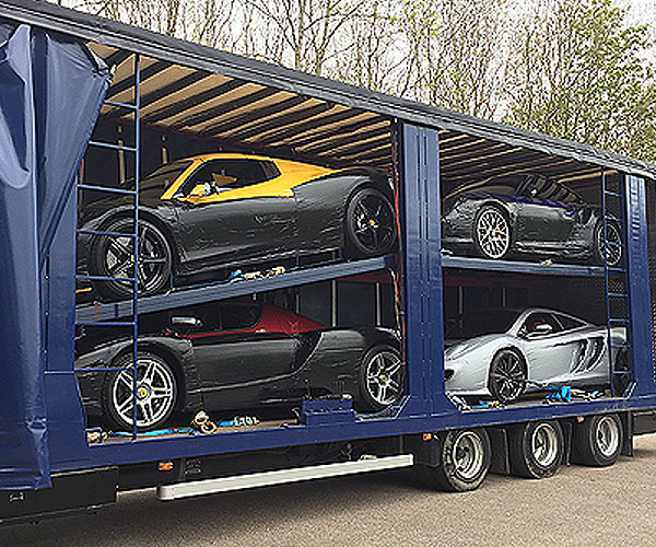 vehicle filled with prestige cars