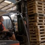 worker using a forklift