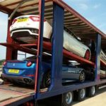 prestige cars in a vehicle transporter