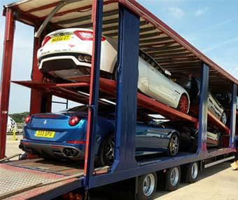 prestige cars in a vehicle transporter