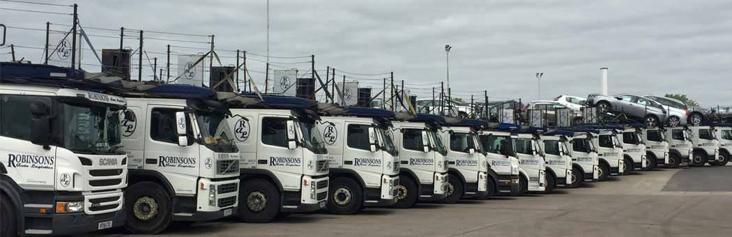 robinsons auto logistics vehicles lined up on their site