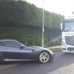Black Ferrari about to be transported by a RAL Vehicle