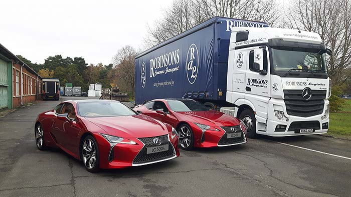 Ral Truck with 2 Lexus cars from the side