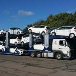 a robinsons auto logistics vehicle loaded up with cars to transport