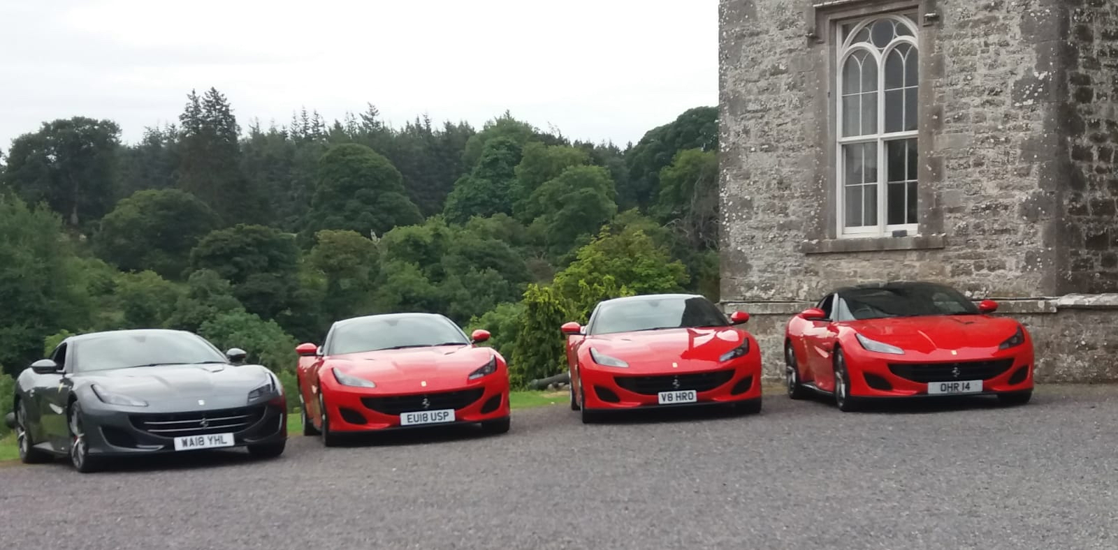 super cars on driveway delivered by Robinsons